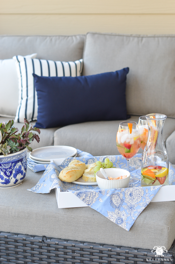 Outdoor living and romantic ottoman tablescape with snacks