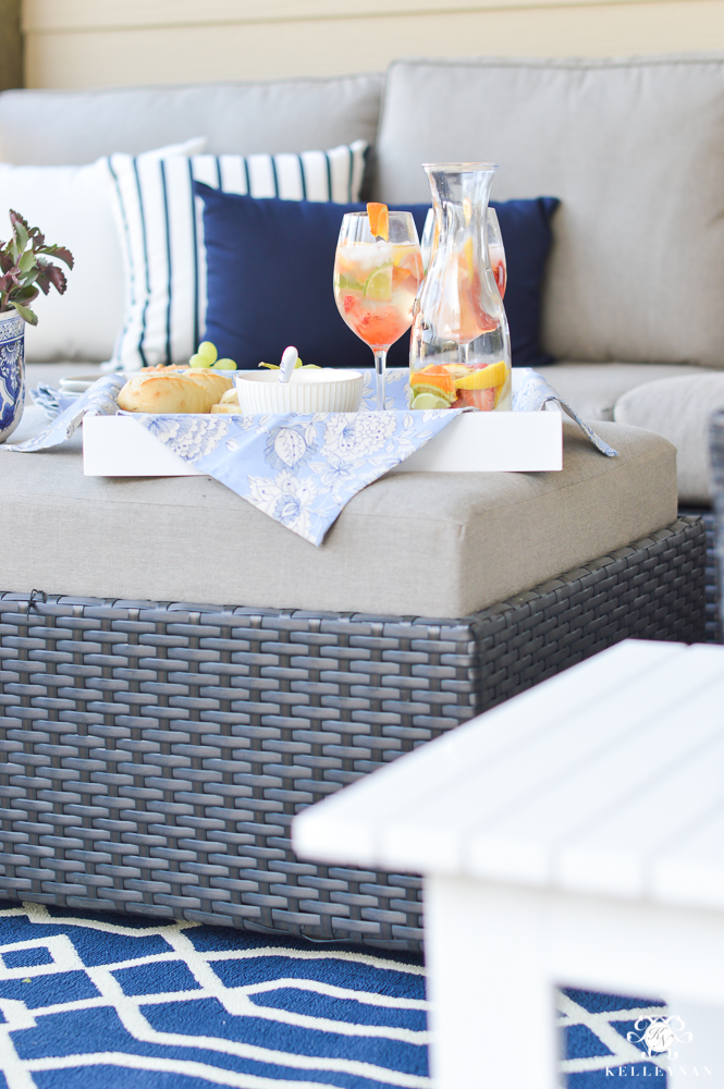 Outdoor living area with blue and white pillows