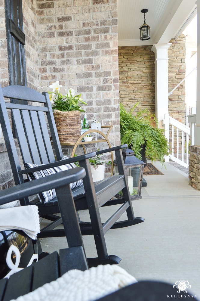 Spring Decorated Rocking Chair Front Porch with a Gold Bar Cart Polywood Black Rockers and Garen Stool