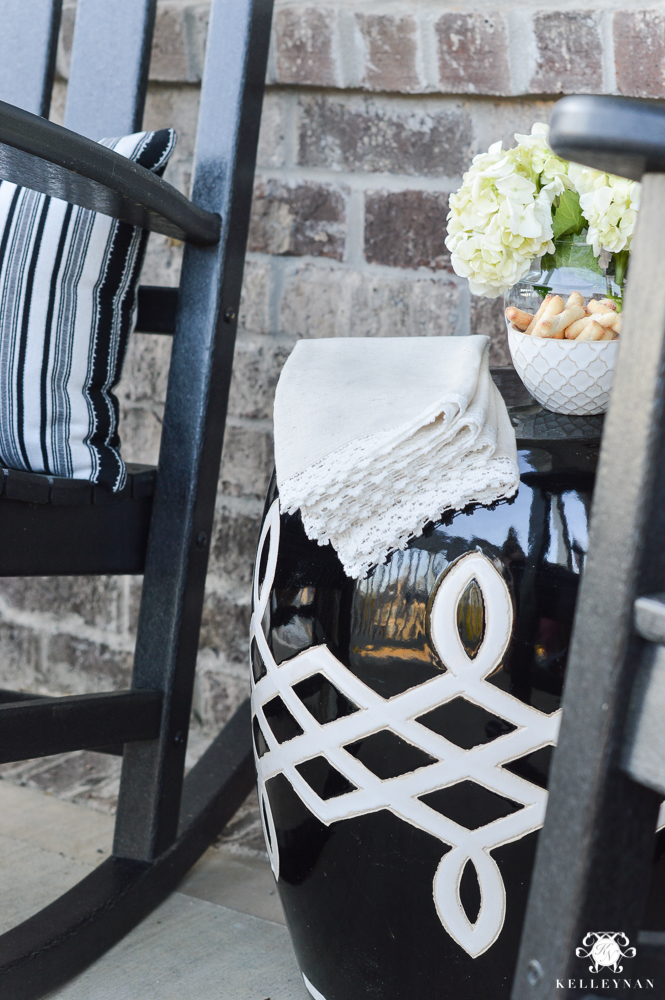 Spring Decorated Rocking Chair Front Porch with black and white garden stool as table