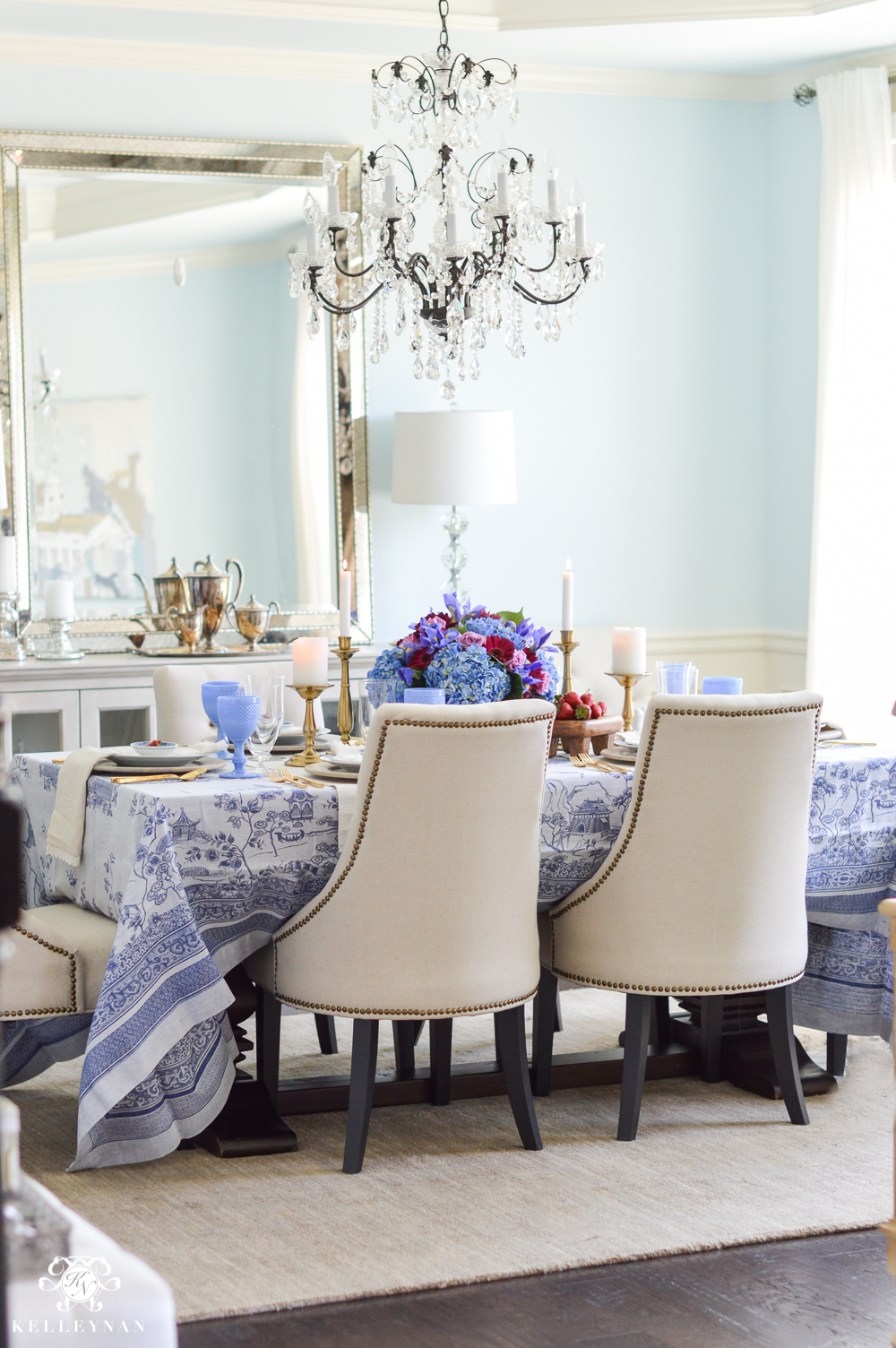 Blue dining room with crystal chandelier