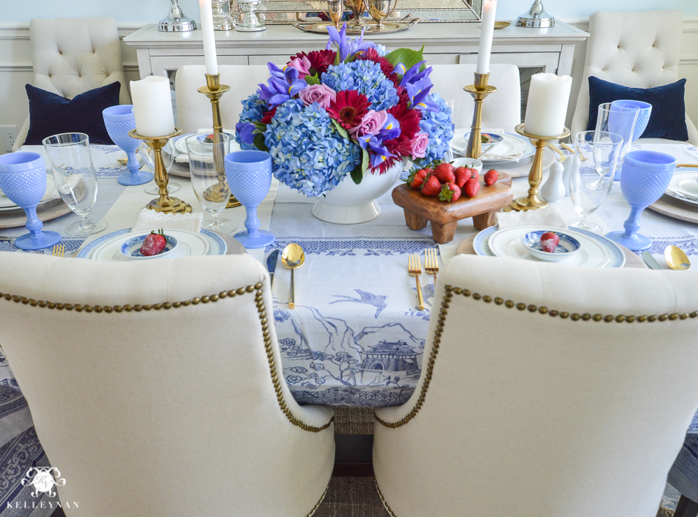 Jewel tone floral arrangement with linen lydia chairs