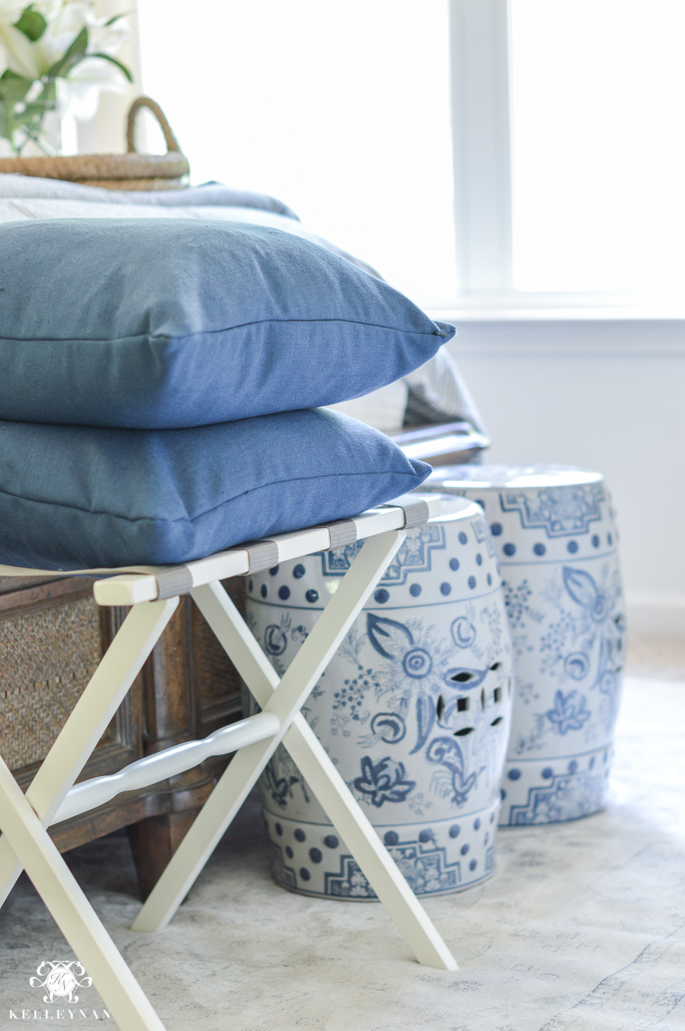 One Room Challenge Blue and White Guest Bedroom Reveal Before and After Makeover- luggage rack and garden stools at the foot of the bed
