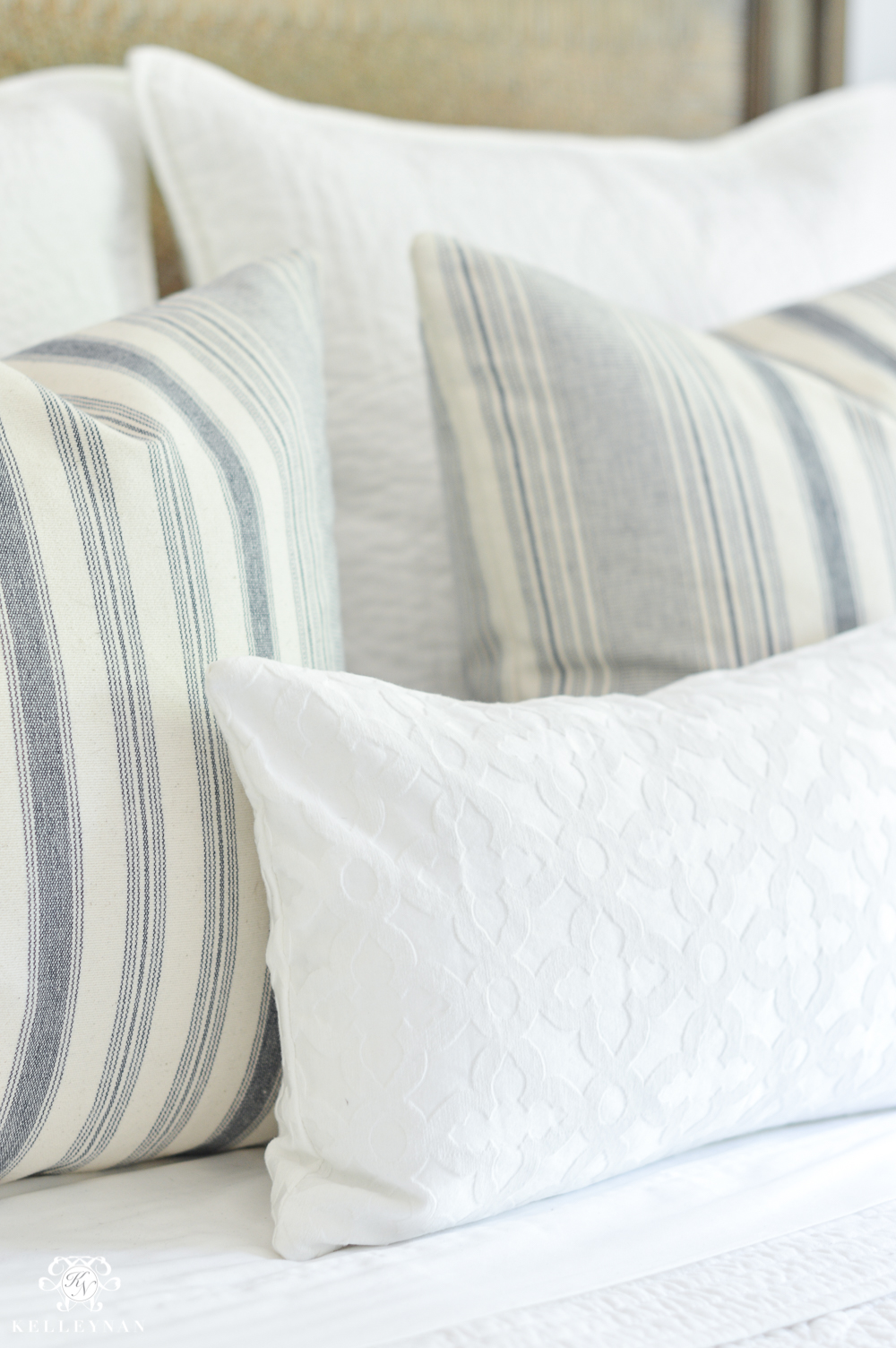 One Room Challenge Blue and White Guest Bedroom Reveal Before and After Makeover- queen bed pillow arrangement