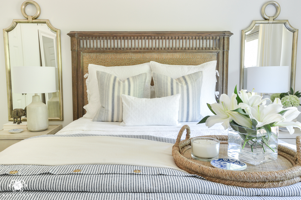 One Room Challenge Blue and White Guest Bedroom Reveal Before and After Makeover- wooden bed and woven tray with mirrors on either side of bed