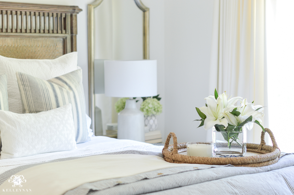 One Room Challenge Blue and White Guest Bedroom Reveal Before and After Makeover- woven bed tray with flowers