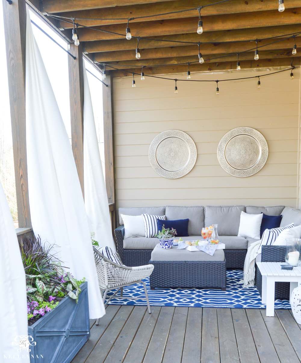 Shades of Summer Home Tour Decorated Back Porch with Sectional and Twinkle Lights and Outdoor Curtains