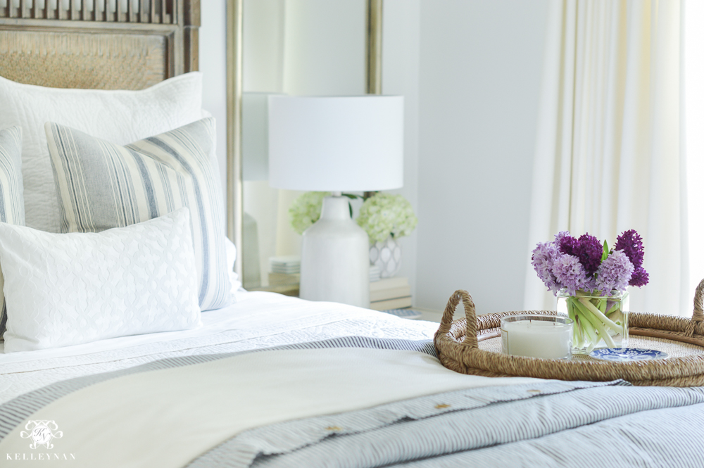 Shades of Summer Home Tour with Neutrals and Naturals- Blue and white guest bedroom with purple flowers