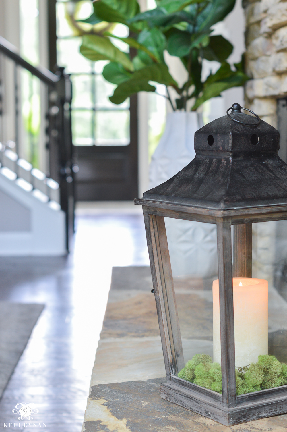 Shades of Summer Home Tour with Neutrals and Naturals- Lantern on fireplace hearth with moss