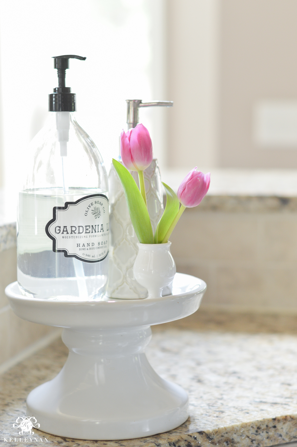 Shades of Summer Home Tour with Neutrals and Naturals-beverage tub stand for soap holder next to sink with bud vase of tulips