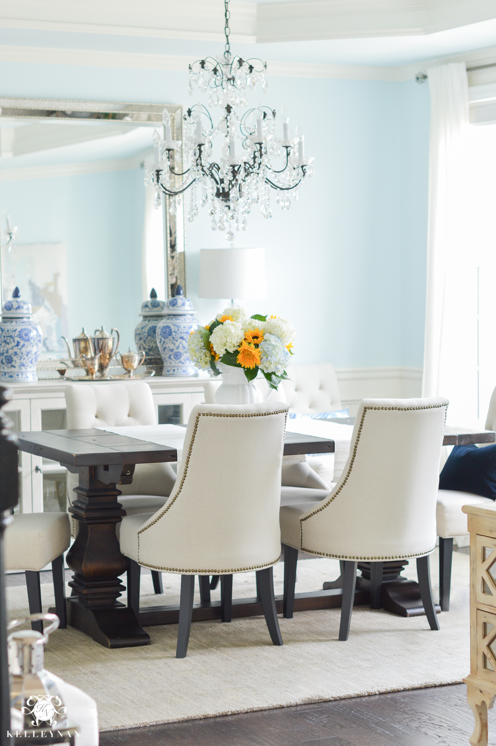 Shades of Summer Home Tour with Neutrals and Naturals- blue dining room with elegant chandelier- lauren's surprise by sherwin williams
