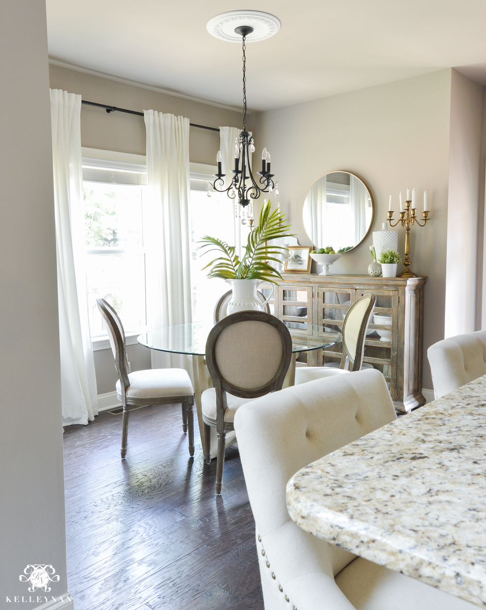 Shades of Summer Home Tour with Neutrals and Naturals- breakfast nook with white ikea ritva curtain panels and palm leaf arrangement