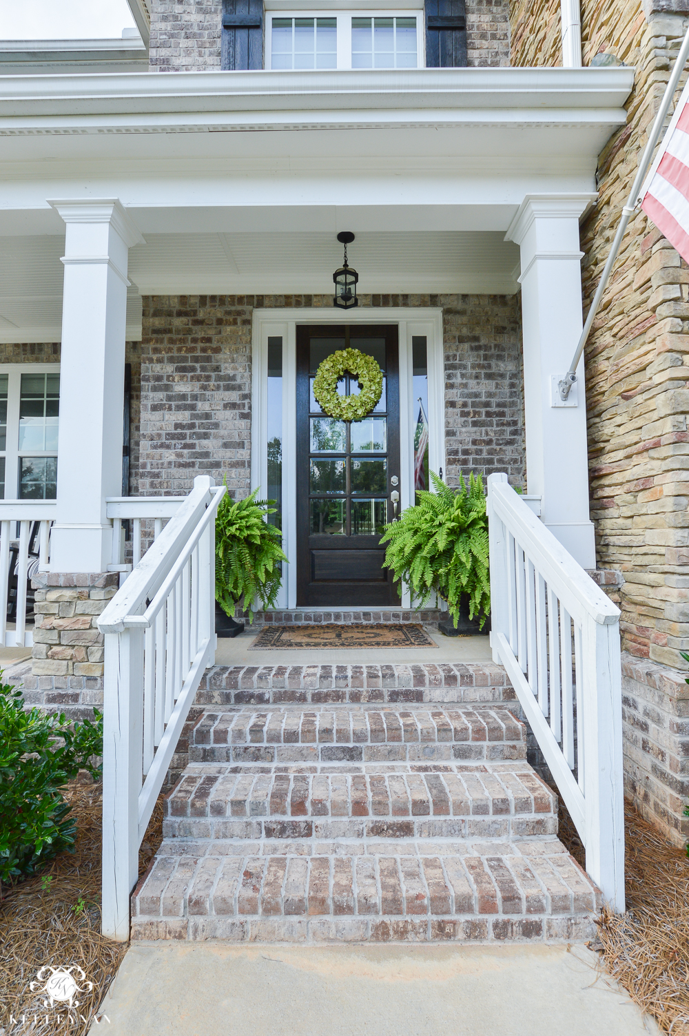 Shades of Summer Home Tour with Neutrals and Naturals- craftsman style home with brick and stacked stone and ferns on either side of door