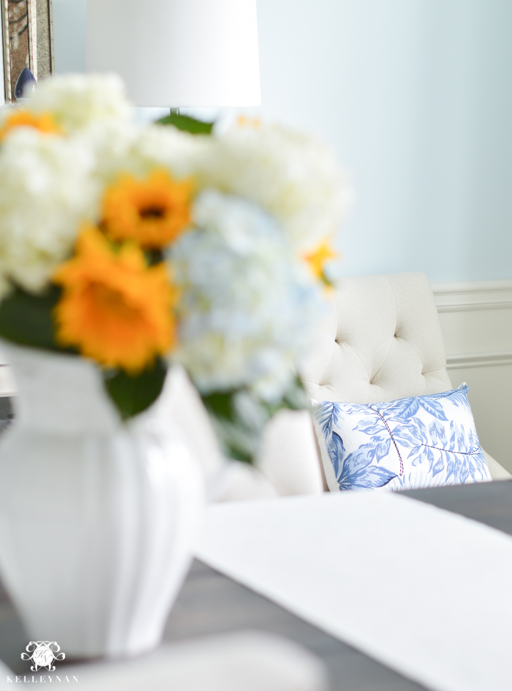 Shades of Summer Home Tour with Neutrals and Naturals- pottery barn blue and white pillows