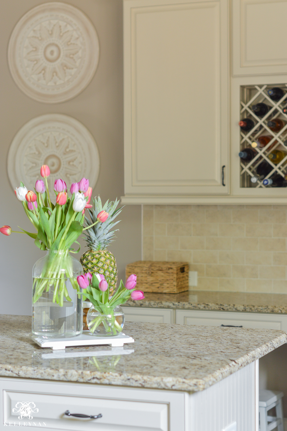 Shades of Summer Home Tour with Neutrals and Naturals- tulips and pineapple on kitchen island