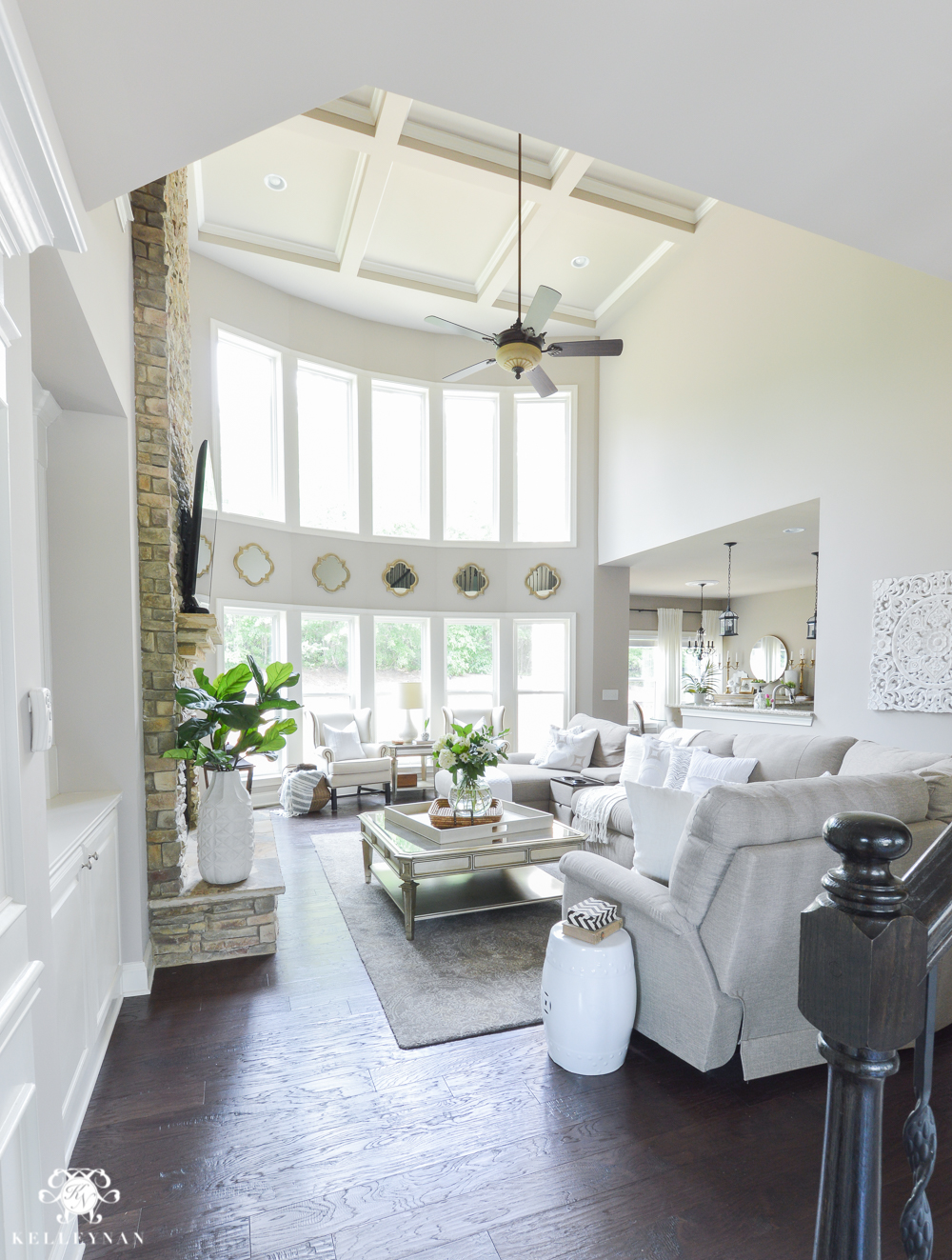 Shades of Summer Home Tour with Neutrals and Naturals-two story great room in sherwin williams versatile gray with bow of windows