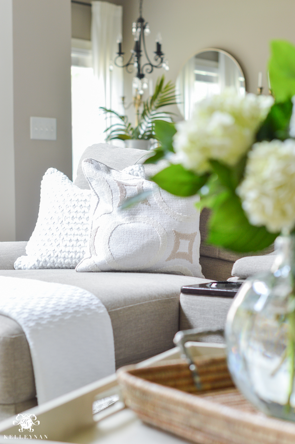 Shades of Summer Home Tour with Neutrals and Naturals- white summer pillows and decor int the living room