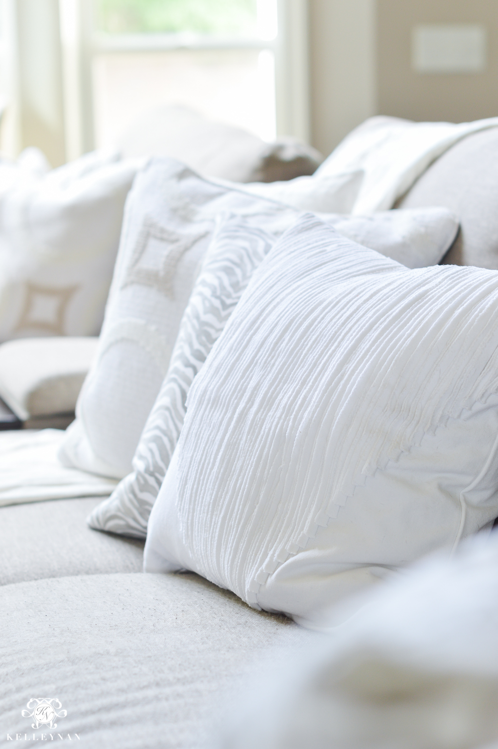Shades of Summer Home Tour with Neutrals and Naturals- white summer pillows on gray sofa