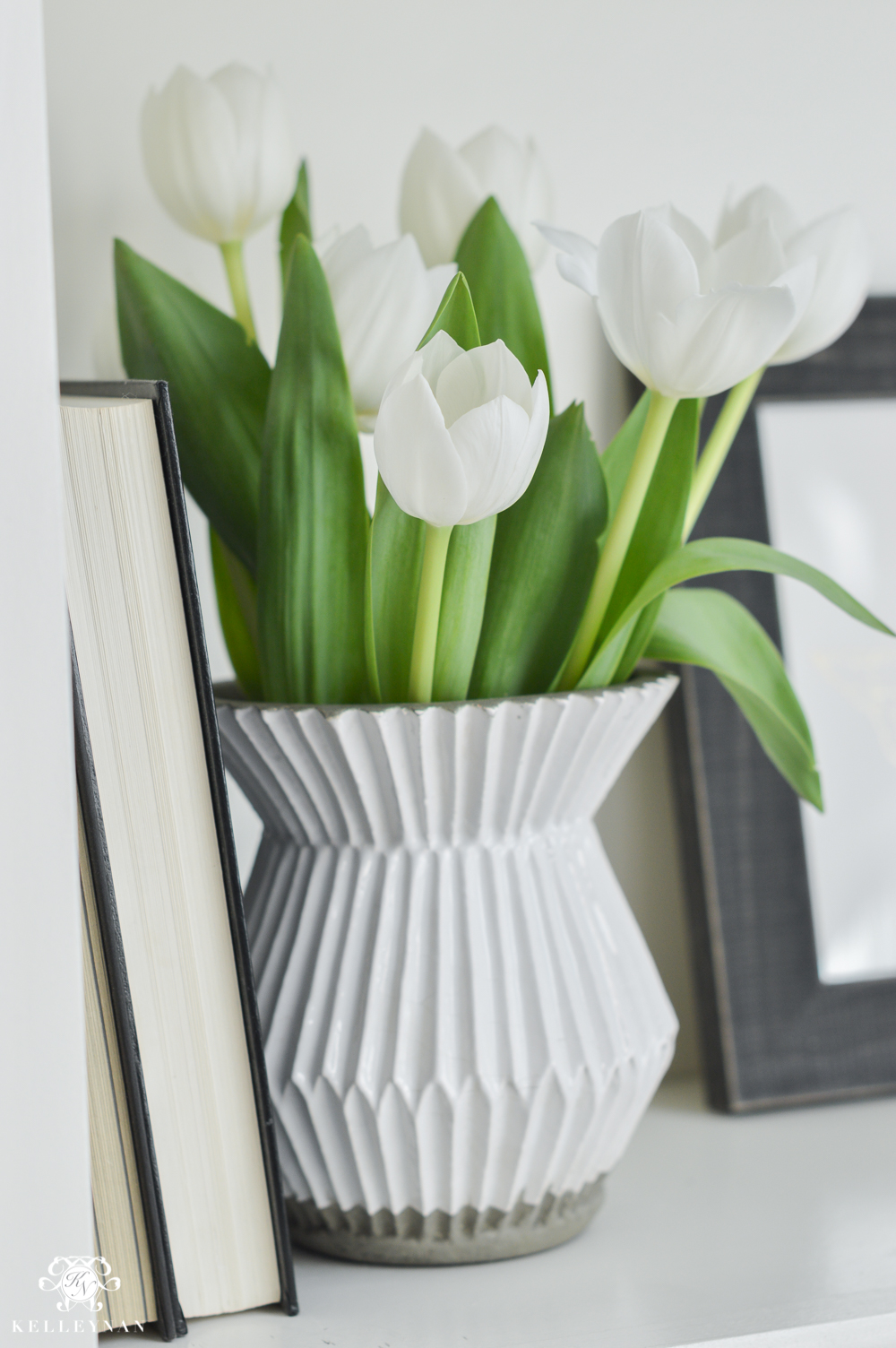 Shades of Summer Home Tour with Neutrals and Naturals- white tulips on shelf with West Elm accordian vase