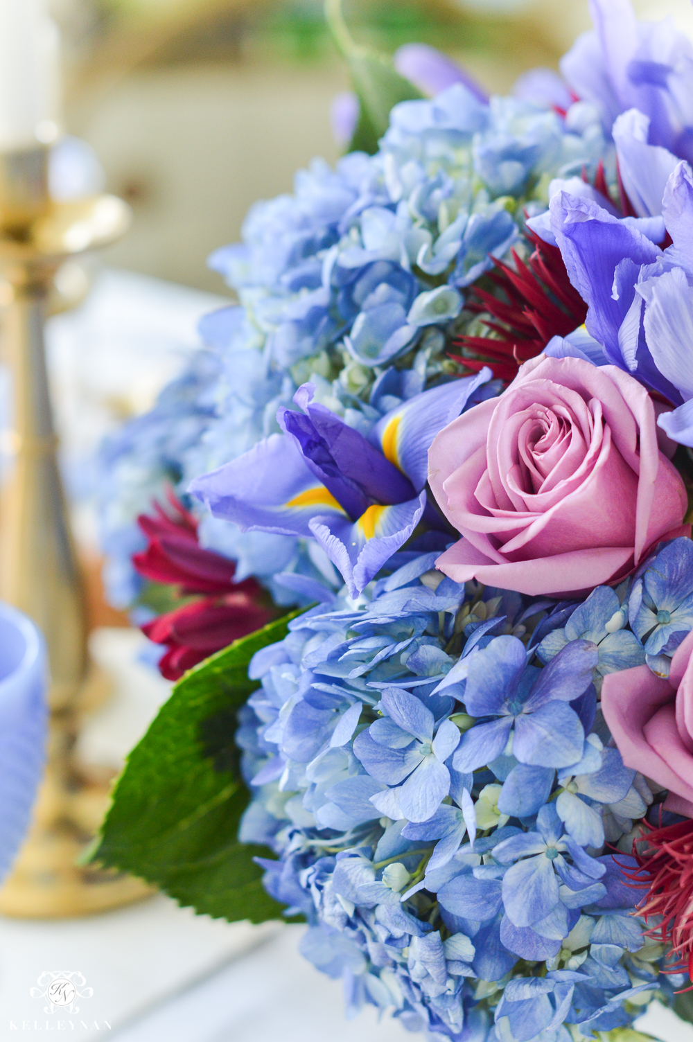 blue hydrangea and purple rose flower arrangement