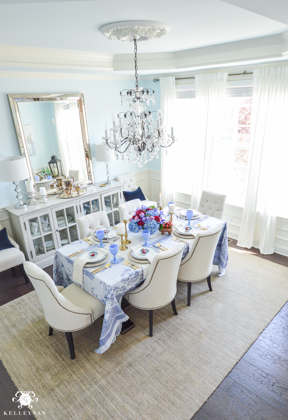 elegant blue dining room with ikea ritva curatins, crystal chandlelier and world market linen lydia chairs