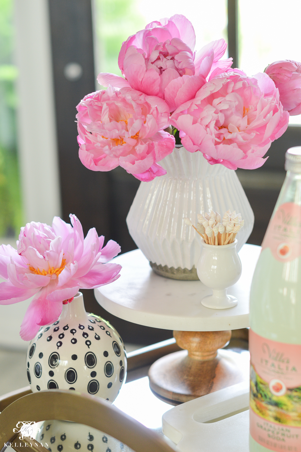 Easy Tropical Bar Cart with Peonies and Pineapple- flower stylying on World Market marble pedestal
