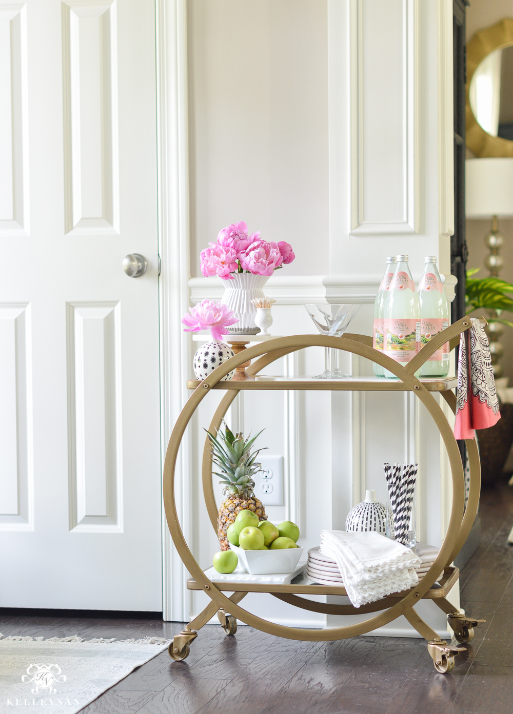 Easy Tropical Bar Cart with Peonies and Pineapple- set up in foyer