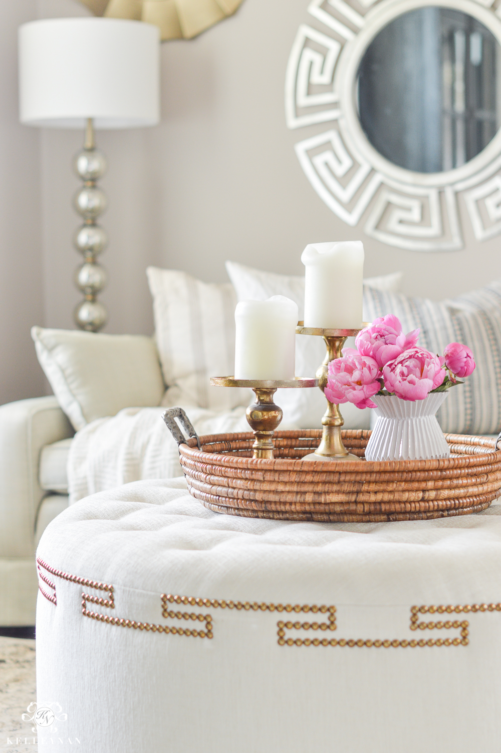 Greek key ottoman with tray and pink peonies
