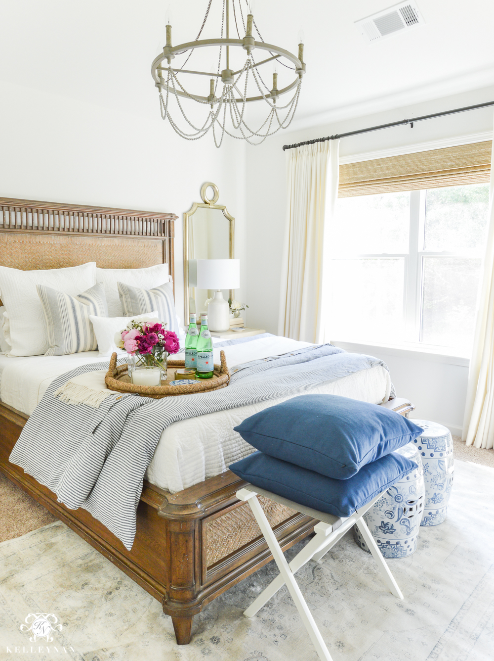 Guest Room Essentials- What every guest bedroom should have- blue and white guest bedroom with chandelier