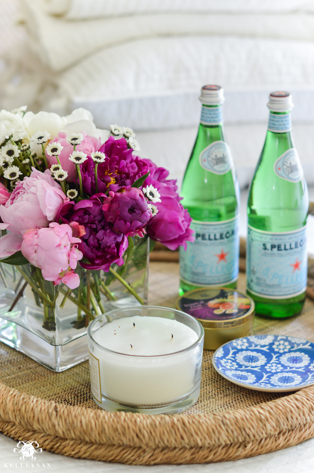 Guest Room Essentials- What every guest bedroom should have- woven tray with san pellegrino