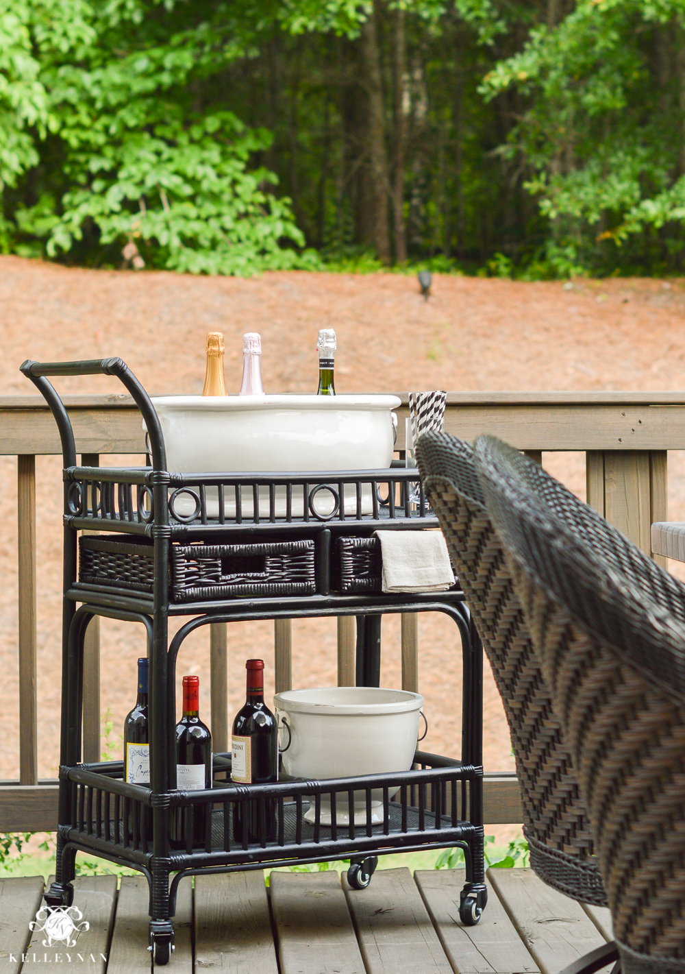 Outdoor Entertaining and Table Ideas with Cheese board appetizer centerpieces- black rattan bar cart outside