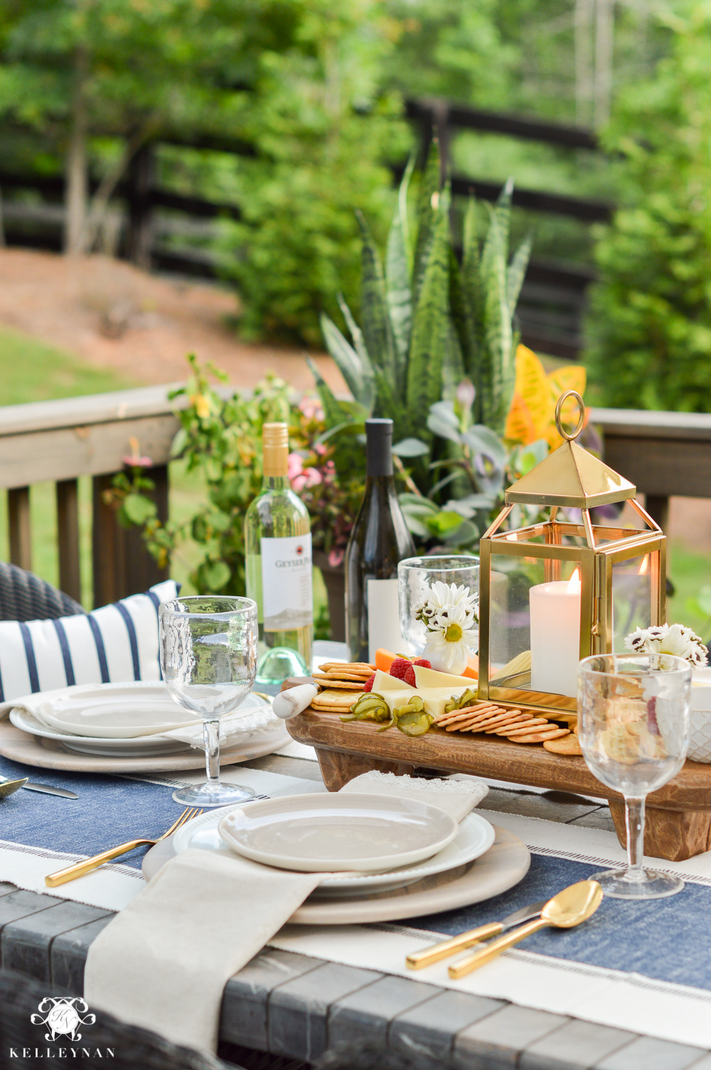 Outdoor Entertaining and Table Ideas with Cheese board appetizer centerpieces- blue and white outdoor place setting