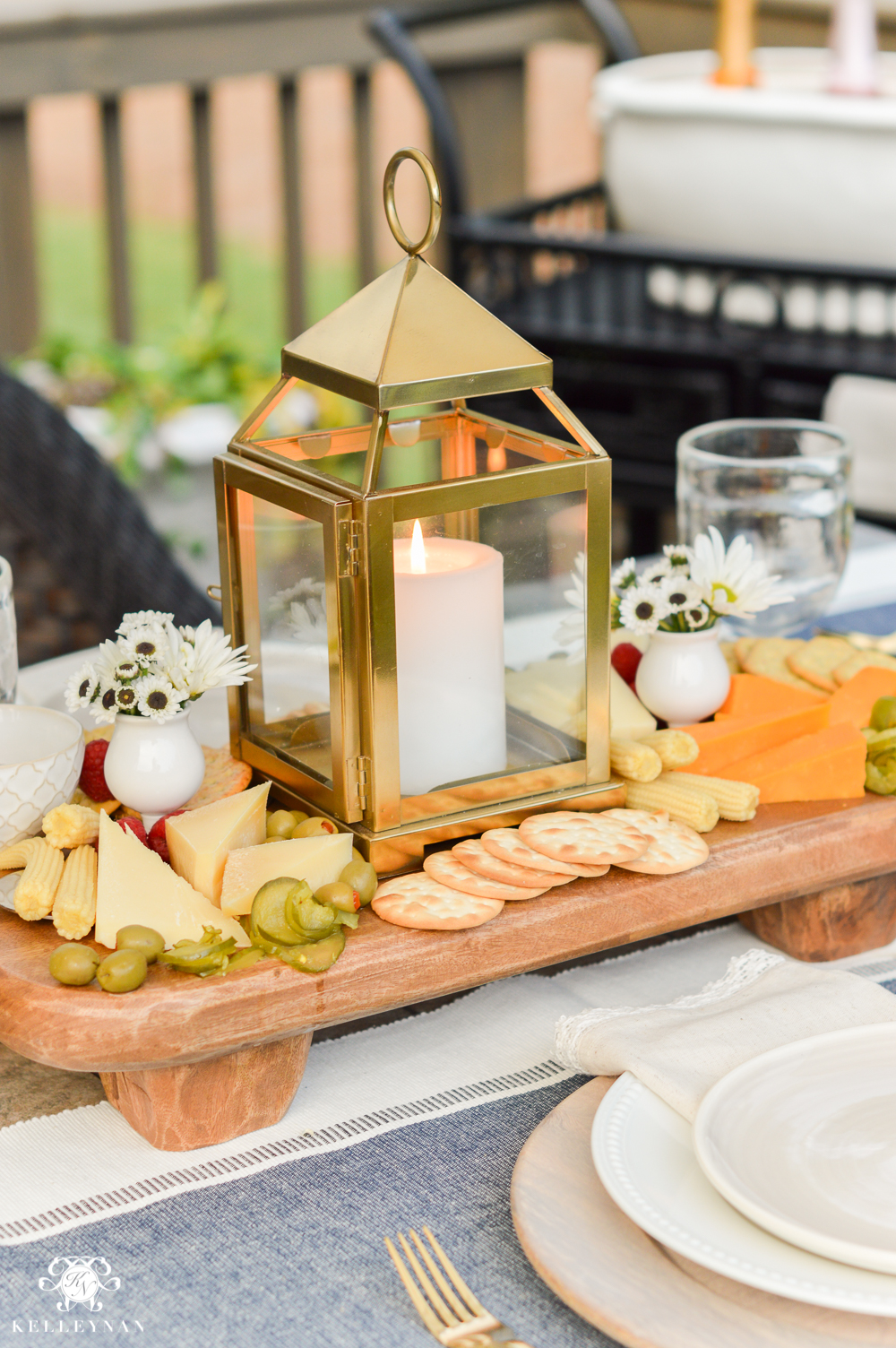 Appetizers and cheese boards a different centerpiece for for Patio table centerpiece ideas