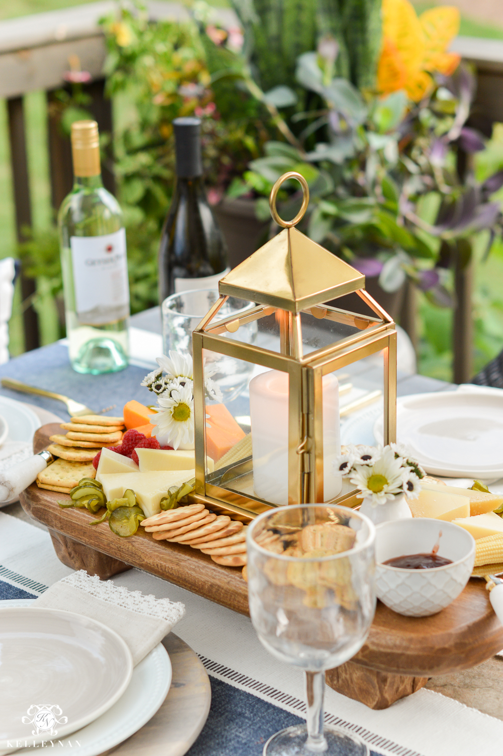 Outdoor Entertaining and Table Ideas with Cheese board appetizer centerpieces- wooden board with lanterns