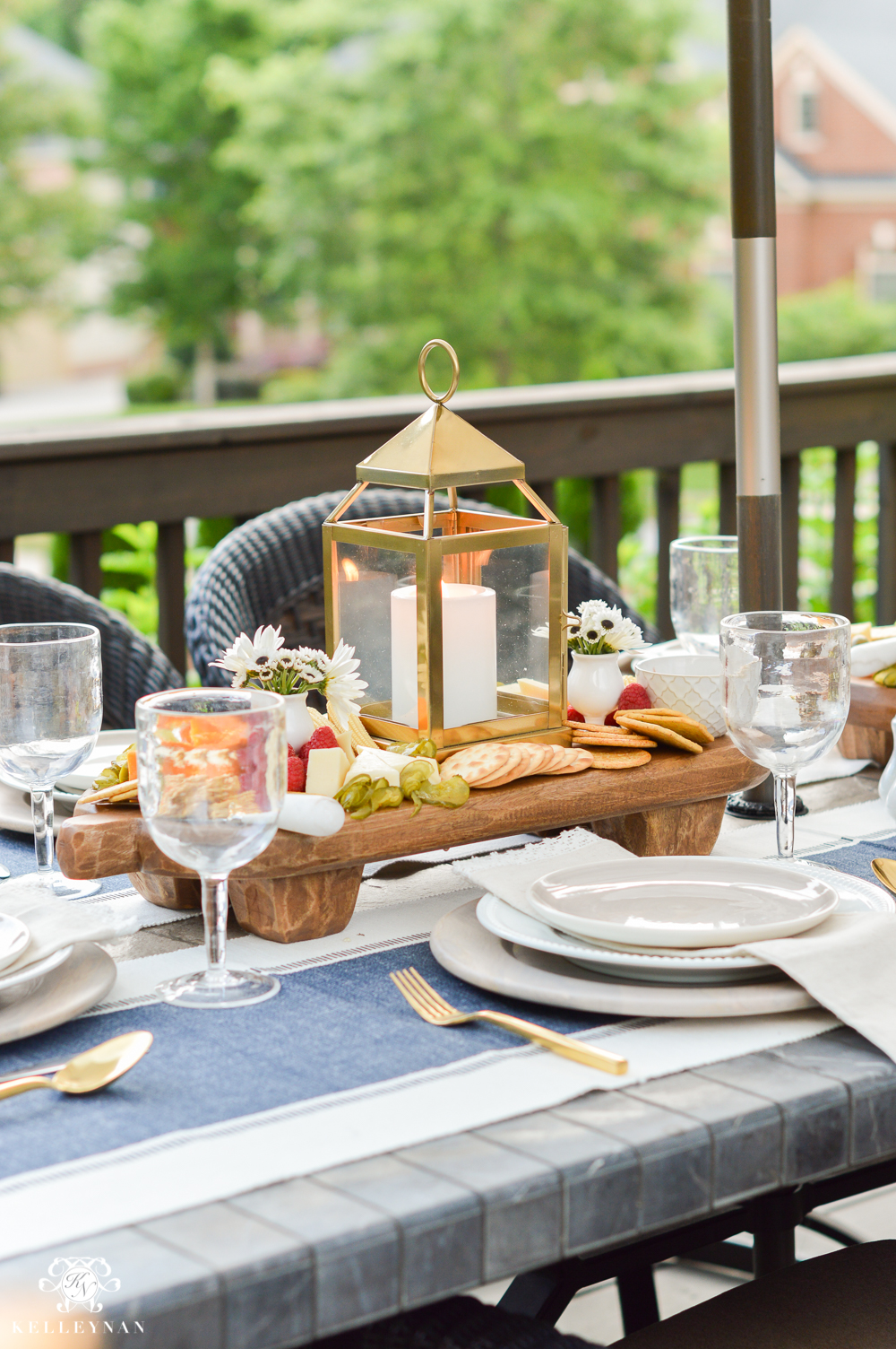 Outdoor Entertaining and Table Ideas with Cheese board appetizer centerpieces- wooden paddle boards from pottery barn