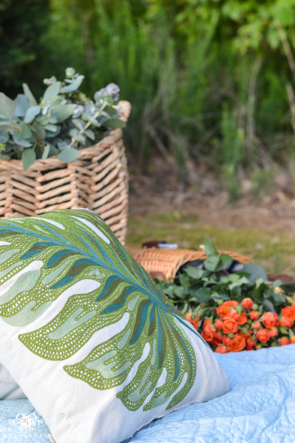 Picnic and Tailgate Ideas and Setup-pillows baskets and flowers