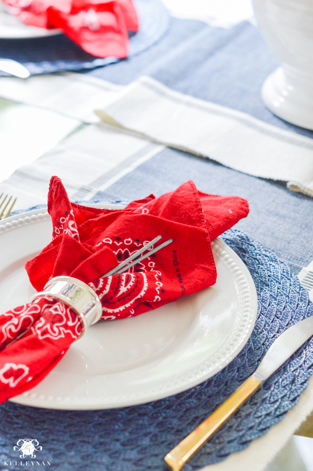 Fourth of July Decor bandanas as napkins with sparklers at place setting