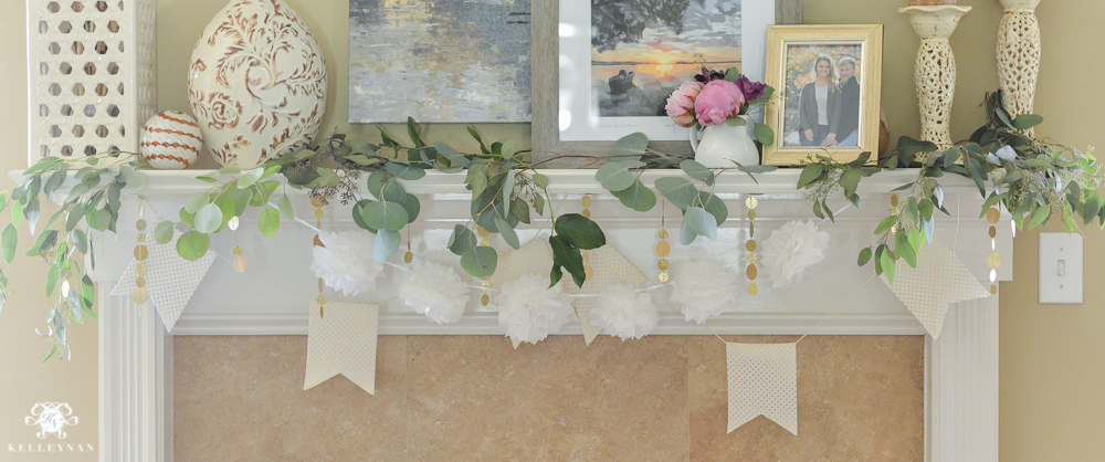 Southern Garden Party Bridal Shower Ideas- fireplace garland with pompoms, banners and greenery