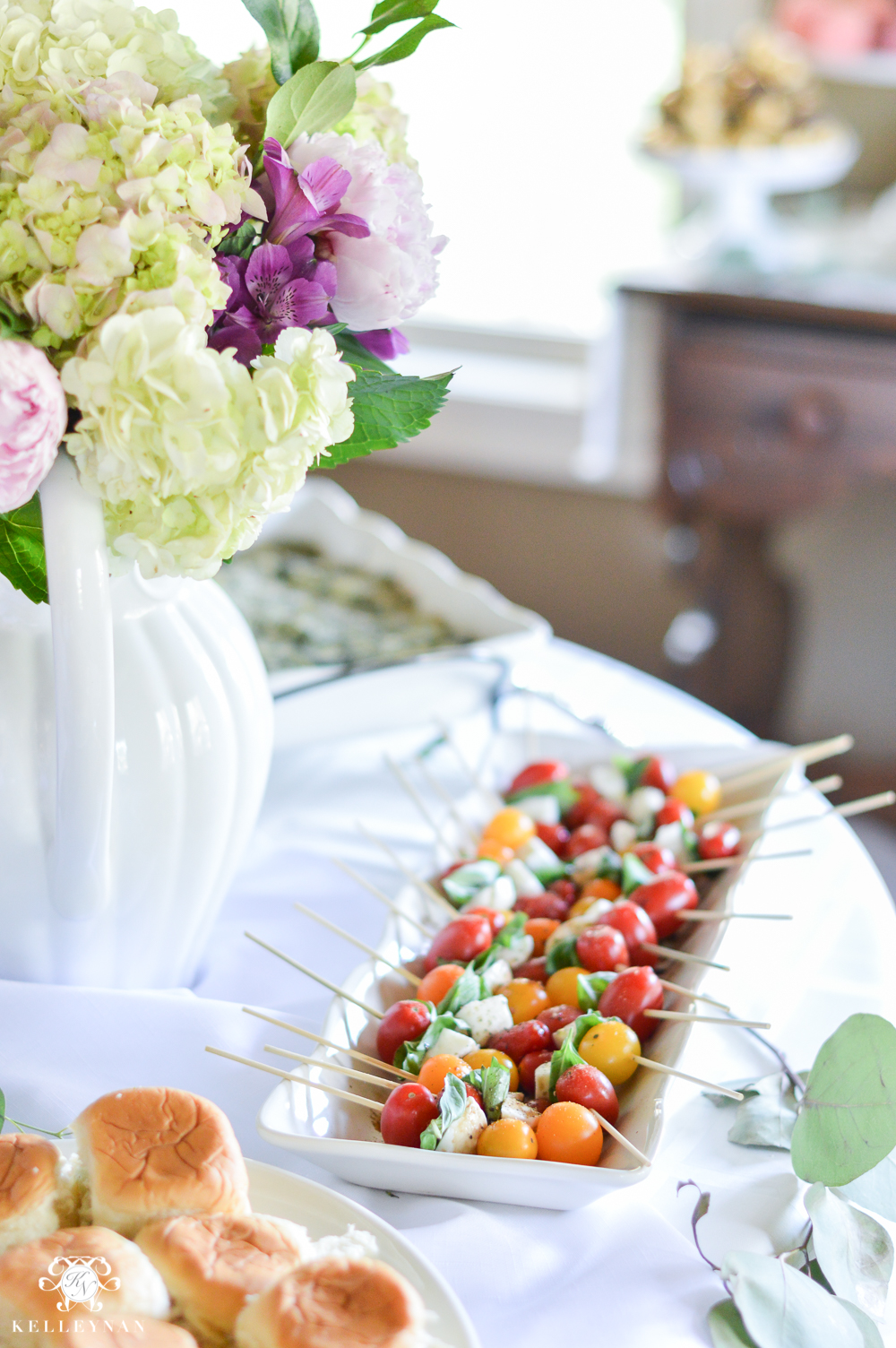 southern garden party bridal shower ideas shower food table setup with caprese skewers