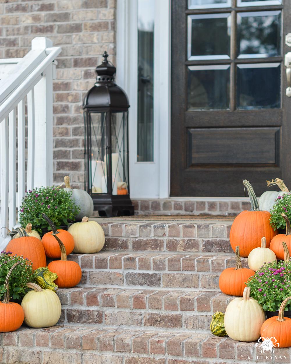 2017 Fall Home Tour with Yellow and Orange Leaves- pumpkins on front porch steps with lanterns