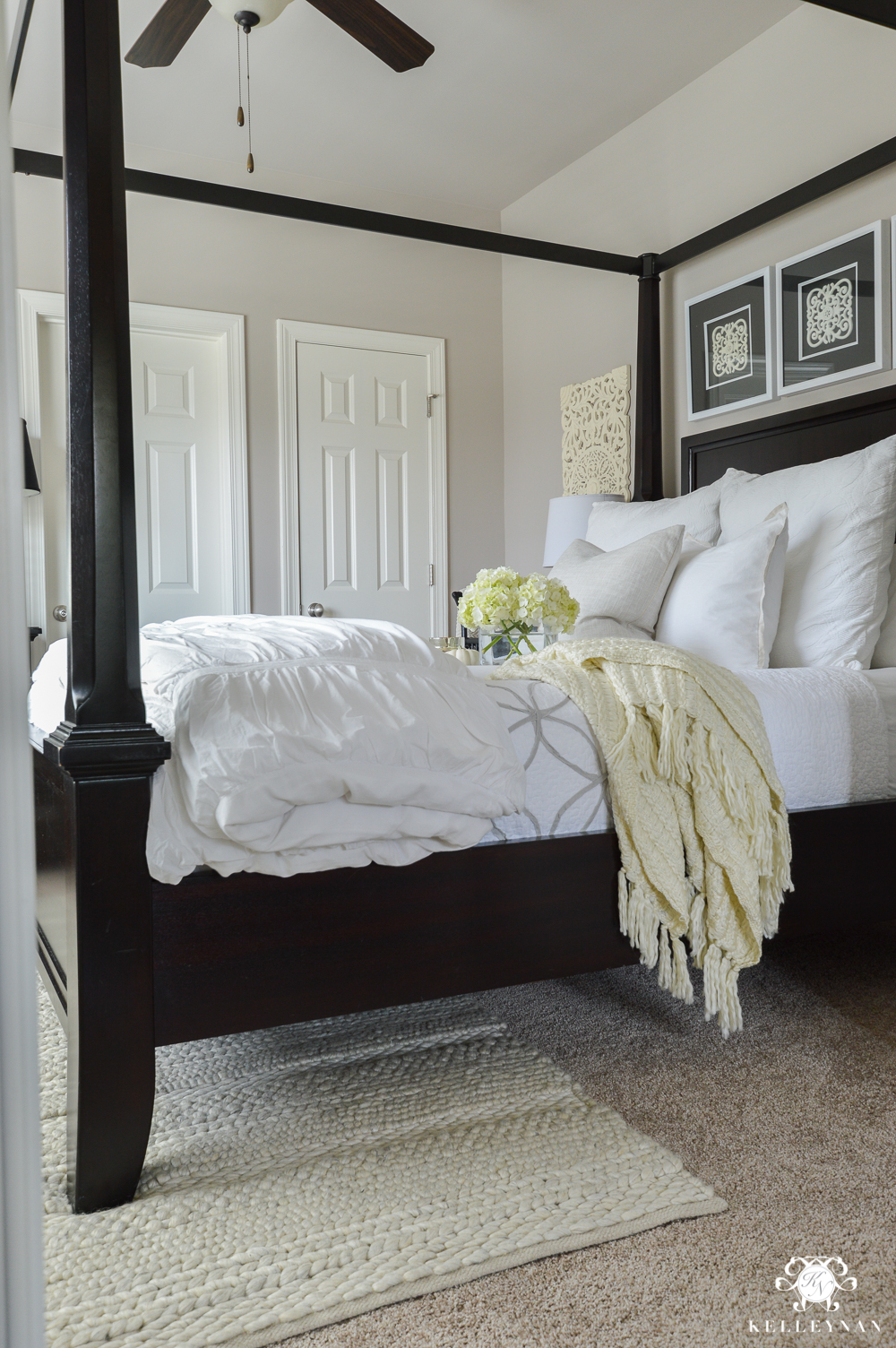 Why Rugs Should Be Layered On Carpet- black canopy bed