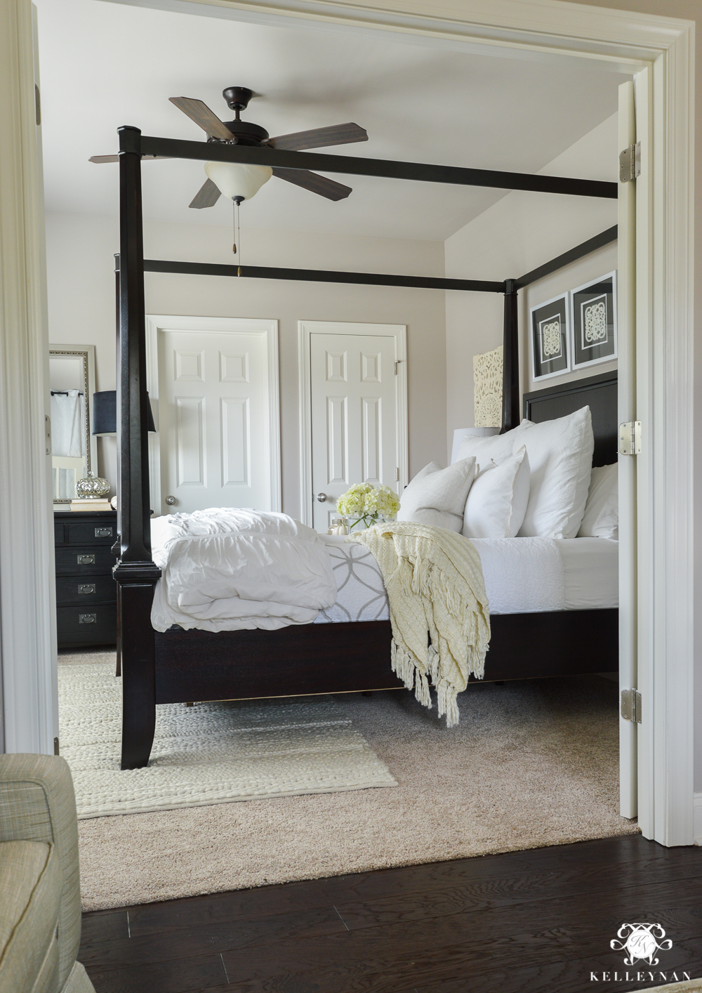 Why Rugs Should Be Layered On Carpet- guest bedroom with canopy bed