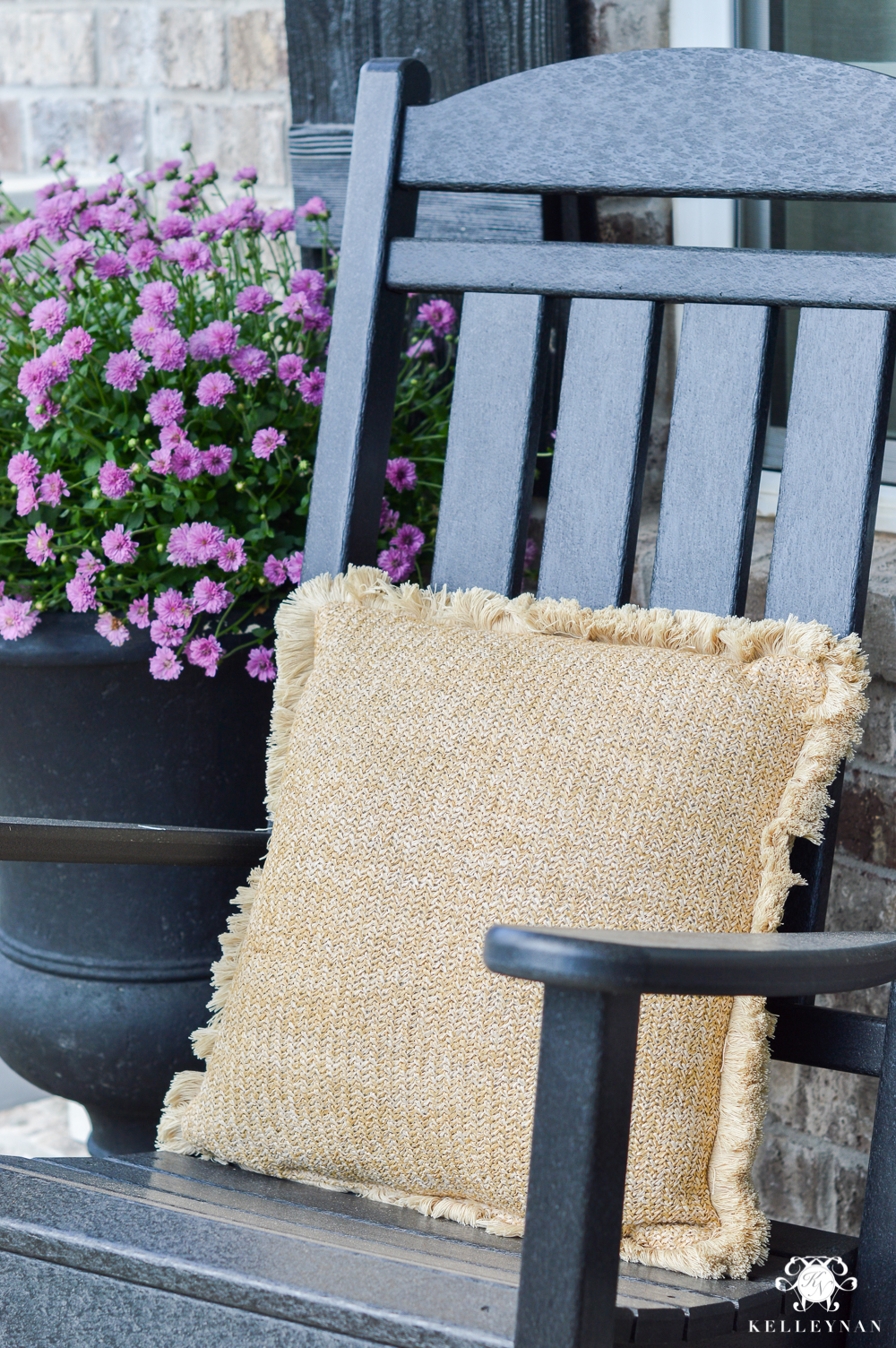 rocking chair front porch with purple fall mums