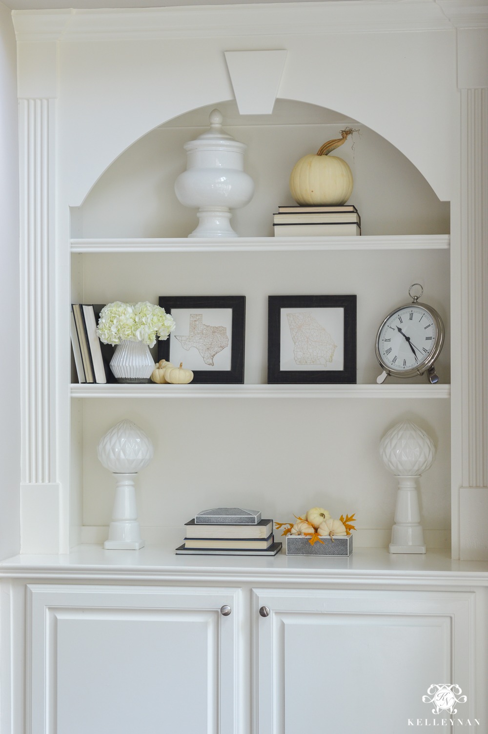 How to style pumpkins on bookshelves