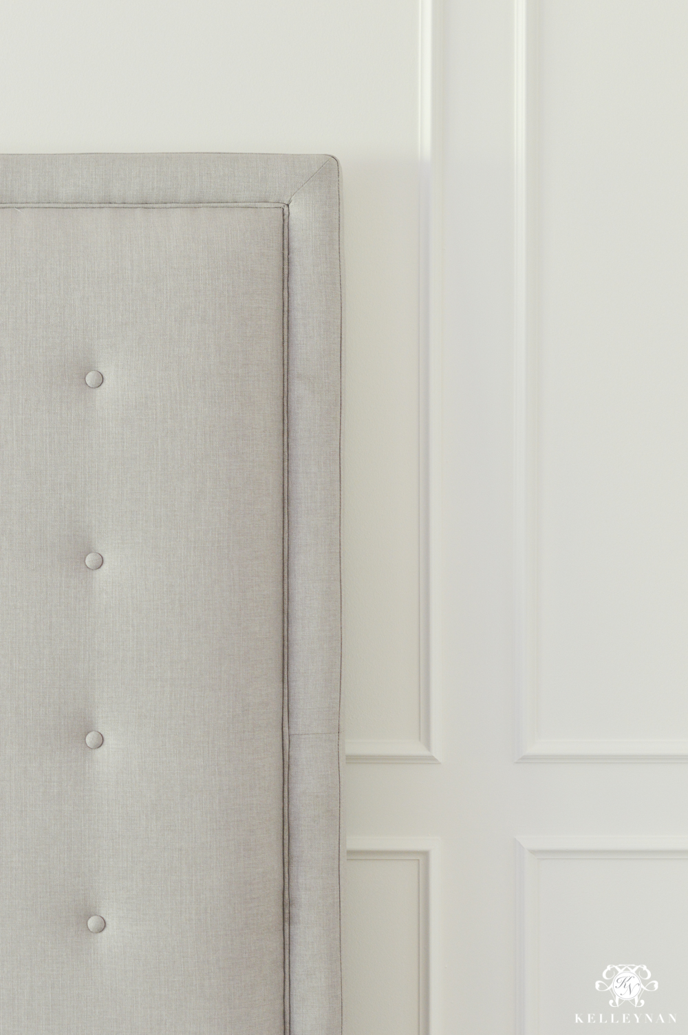 Modern Button Tuft Gray Bed on Paneled Wall
