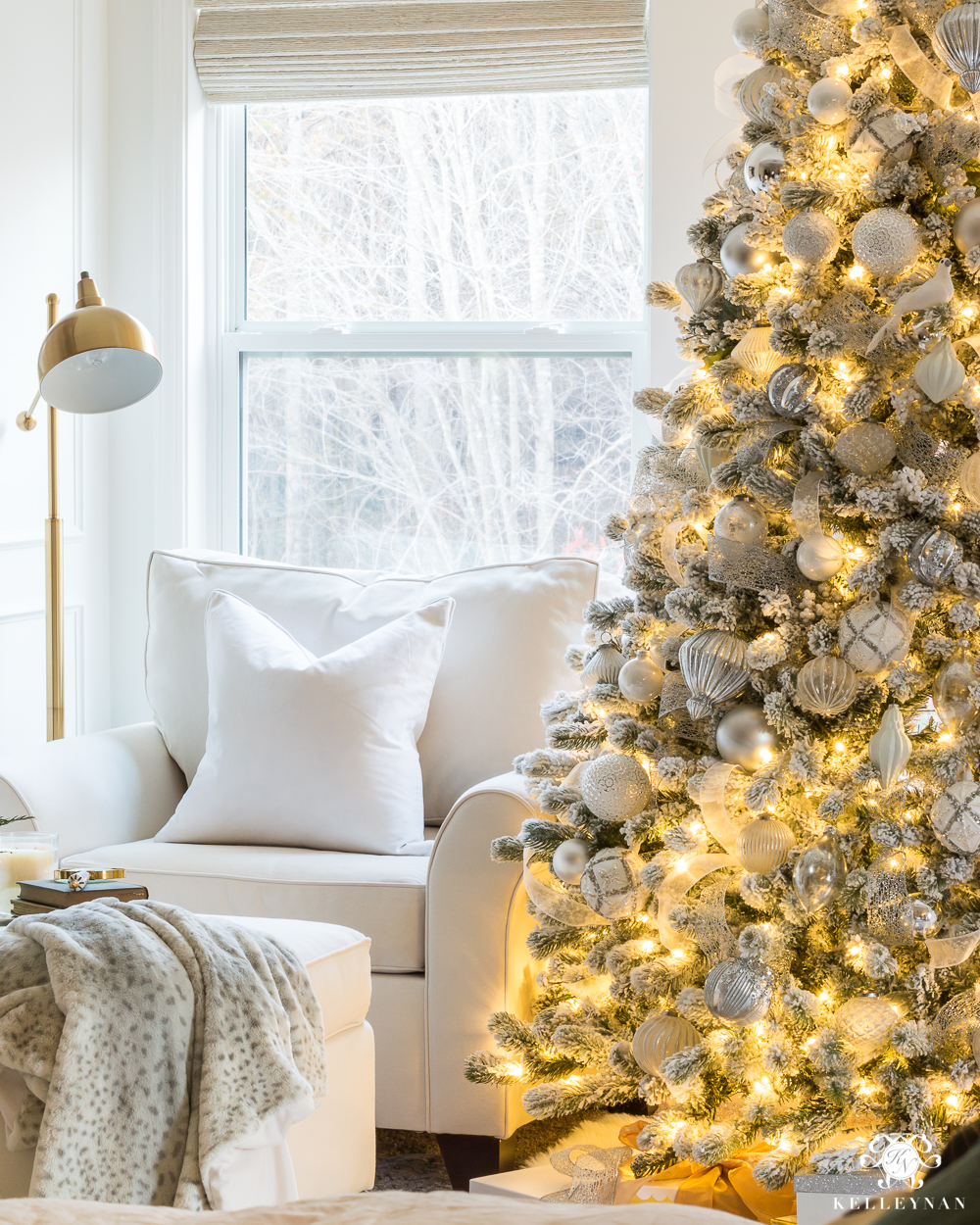 Cozy bedroom sitting area with a flocked Christmas tree
