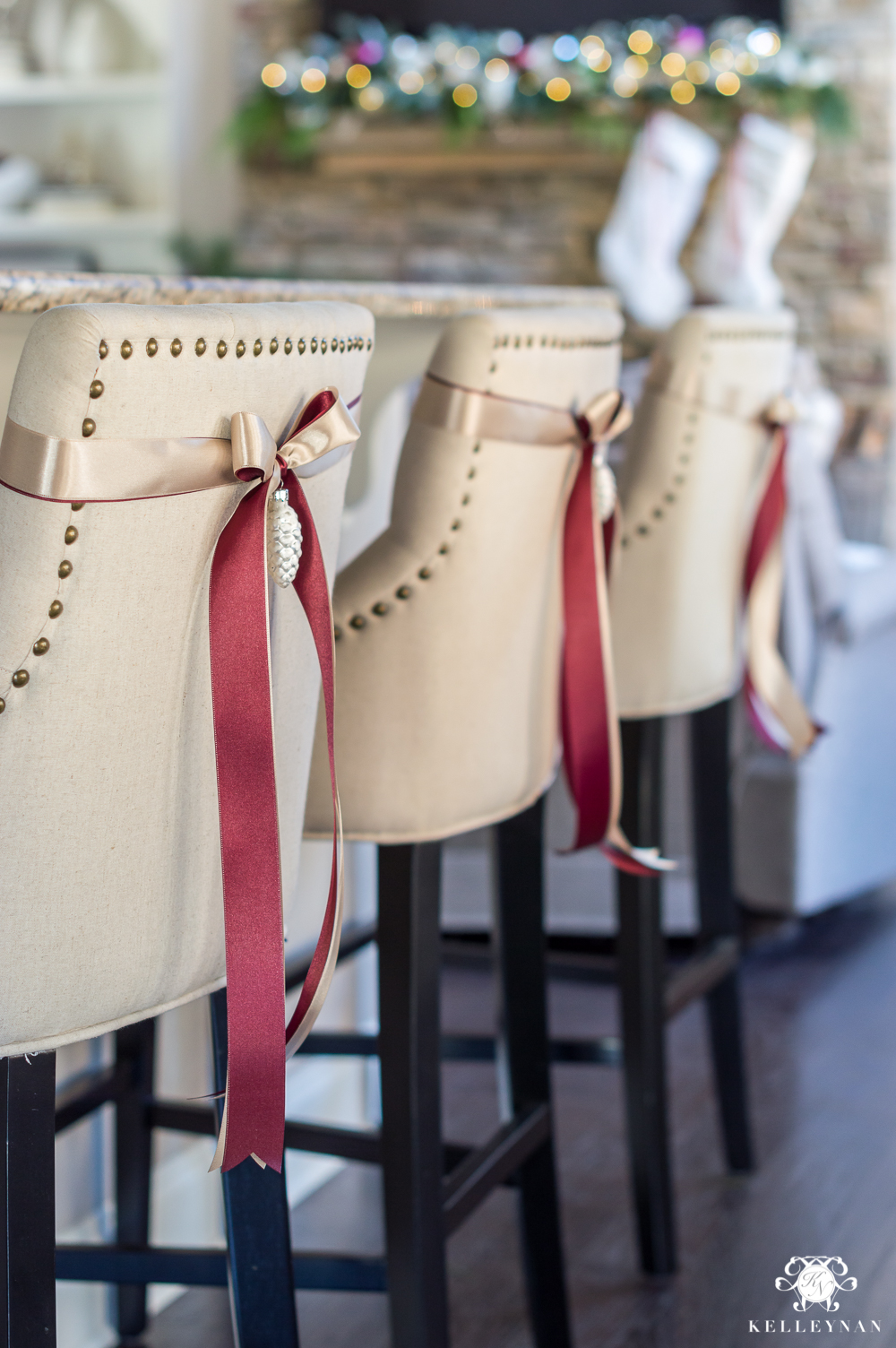 Bar stools with ribbon and an ornament for Christmas