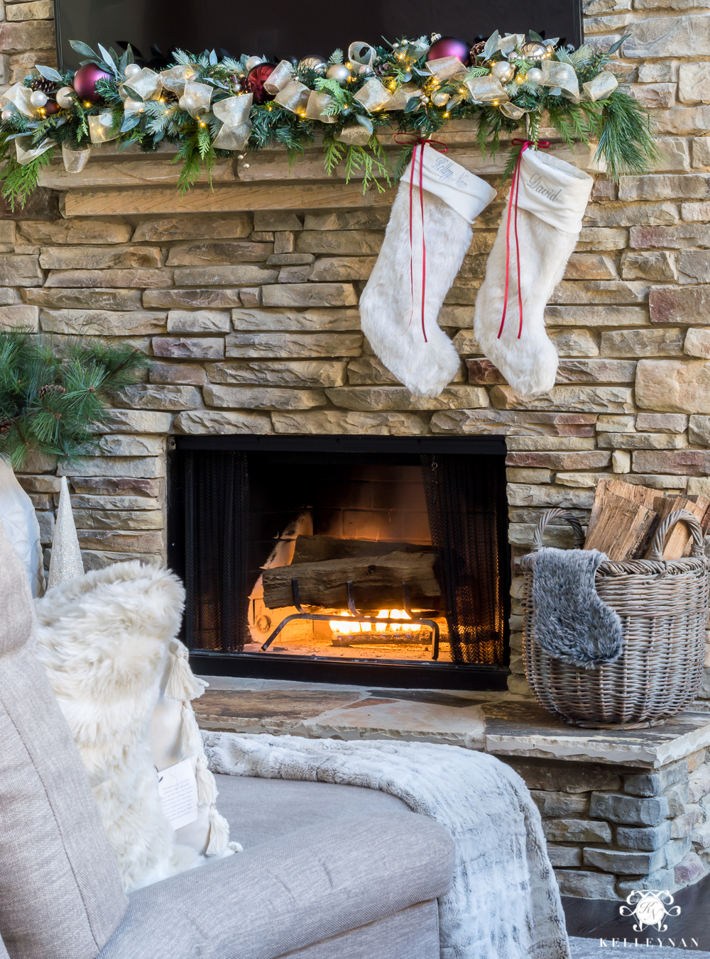 fur stocking ideas hung on a stacked stone fireplace