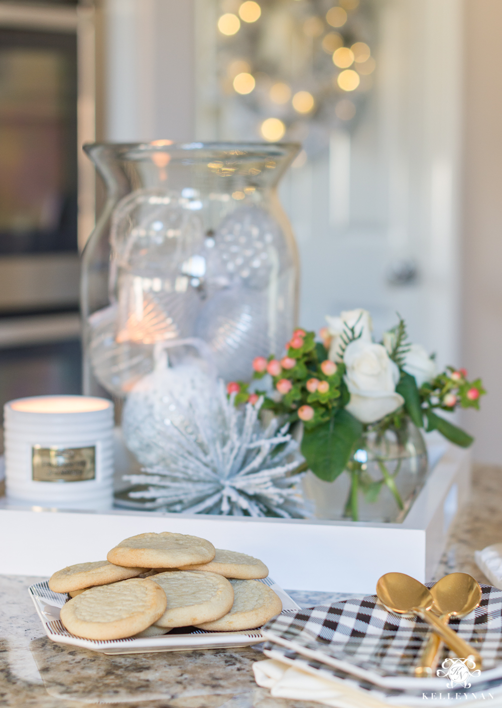 Kitchen island Christmas decor with a jar of ornaments