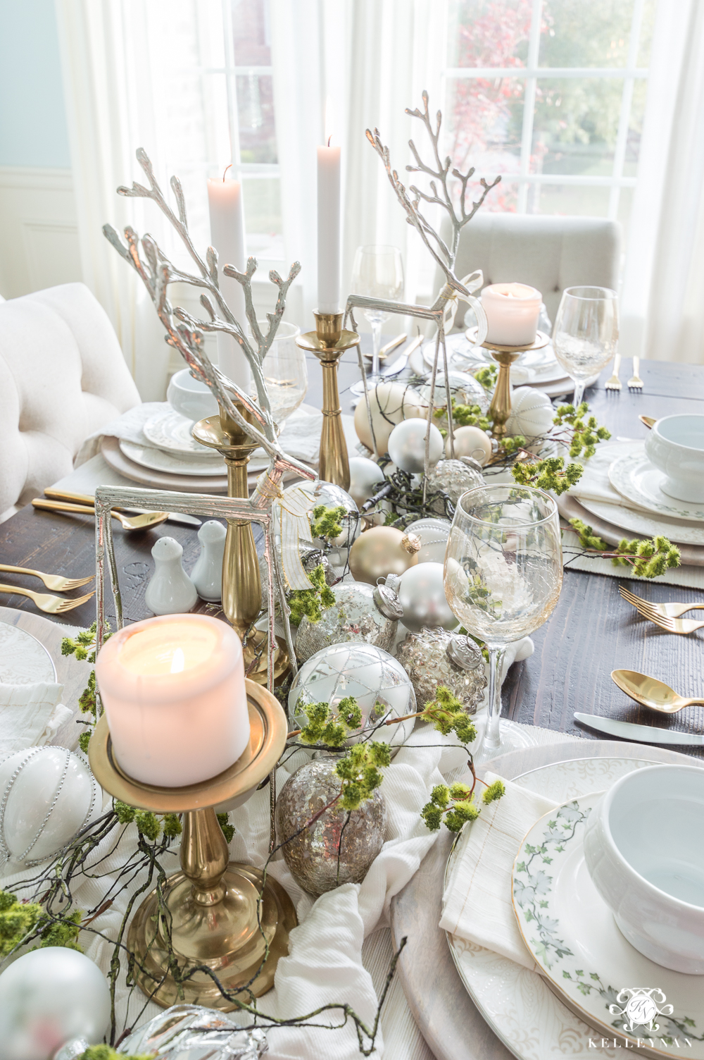 Christmas centerpiece ideas with reindeer, moss, and ornaments